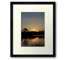last rays in reflections Framed Print