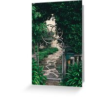 Leafy gate with a bicycle wheel decoration Greeting Card
