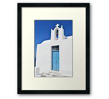 White church with blue door in Santorini, Greece Framed Print