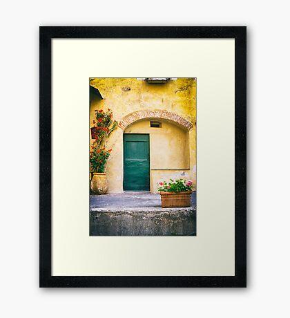 Italian facade with geraniums Framed Print