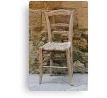 chair in the street Canvas Print