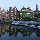 Canal Boats at Dusk, Damrak, Amsterdam. by Trish Meyer