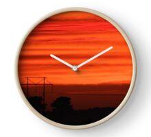 Telephone Poles Against an Orange Sky  Clock