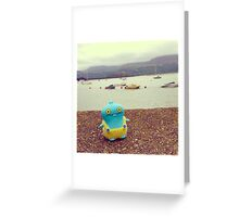 Babo uglydoll on holiday in Wales, UK. Greeting Card
