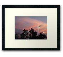Sunset by the light Framed Print