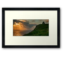 Cliffs of moher sunset in county clare ireland with castle tower over looking aran islands on the wild atlantic way Framed Print