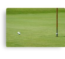 Golf balls near flagstick Canvas Print