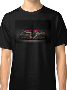 Old and dirty grey girl's sneakers isolated on black background Classic T-Shirt
