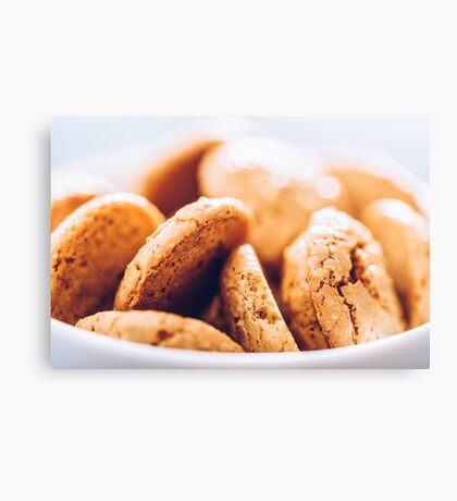 Italian Amaretti Biscuits In White Bowl Canvas Print