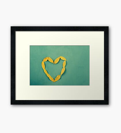 Heart Shape Yellow Autumn Leaves On Turquoise Wood Table Framed Print