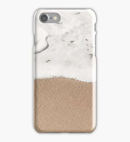 Wave gently washes up on a sandy beach iPhone Case/Skin