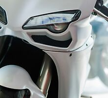 white motorcycle close up photo by Anna Váczi