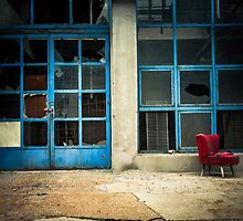 Industrial exterior with red chair and window by Anna Váczi