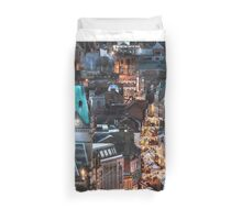 Elevated city view at night with Christmas market stalls  Duvet Cover