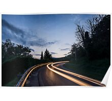 Lights on the asphalt, at sunset on a mountain road Poster