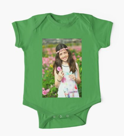 Young preteen girl of 12 in white dress in a hothouse of pink flowers  One Piece - Short Sleeve