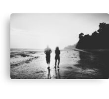 walking on the with sunset light in black and white Canvas Print
