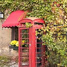 An old style telephone booth by Josef Pittner