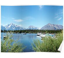 Beautiful Grand teton National Park. Landscape photography of lake, blue sky, mountain, boat and green bushes. Poster