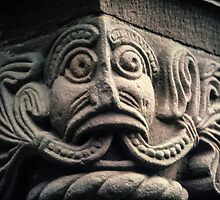 Face with split tongue on Saxon door framing Church Kilpeck England 198405170013 by Fred Mitchell