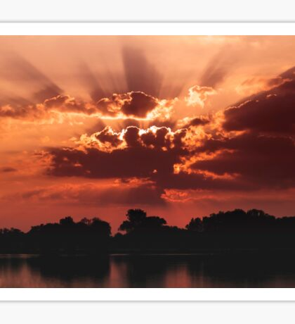 Outstanding sunset with beautiful sunbeams. Red sunset over the lake Sticker