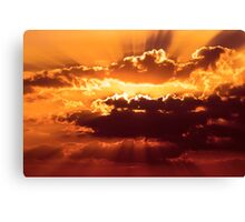 Outstanding sunset with beautiful sunbeams. Red sunset behind the clouds Canvas Print