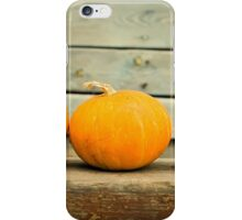 Pumpkins on a wooden background iPhone Case/Skin