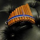 Ornamental Pan Pipes on Piano Stool by MidnightMelody