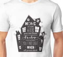 Typography poster with hand drawn elements. Inspirational quote. Home is not where you are from it is where you find light when all grows dark. Unisex T-Shirt