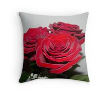 three red roses Throw Pillow