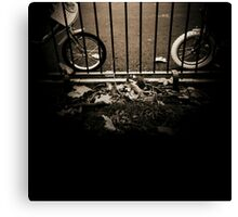 Childrens bicycles against park railings  black and white sepia tone 35mm silver gelatin analog photo Canvas Print