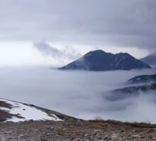 The misty mountains. Panoramic photo of a mountains during winter Sticker