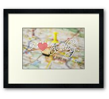"""Typography poster with the text """"I love travelling"""". Picture with the inscription. Map background. Pink heart Framed Print"""