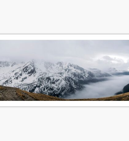 Panorama of mountains. The Tatra Mountains in the snow and fog. Beautiful photo of the rocky mountains in Poland Sticker