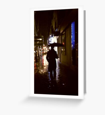 Man walking in street at night in rain color 35mm analogue photojournalism portrait photograph Greeting Card