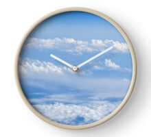 Beautiful cloudscape on a blue sky as seen from above  Clock