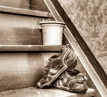 Old children's shoes on a stairway by pASob-dESIGN