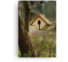 A birds' nest hangs from a tree Canvas Print