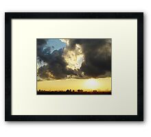 Sunset clouds over New York City  Framed Print