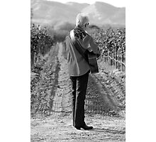 A man plays guitar in a vineyard Photographic Print