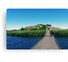 Wooden pier to the island. Bicycle on the wooden bridge. Karlskrona, Sweden Canvas Print