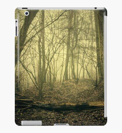 Horror fairytale forest. Forest path in the fog. Fallen tree. iPad Case/Skin