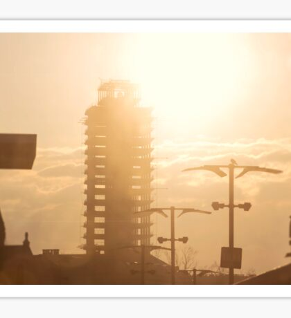 The abandoned skyscraper. Sunrise over the city Sticker