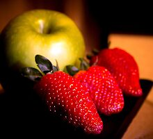 A green apple and three strawberries by GemaIbarra