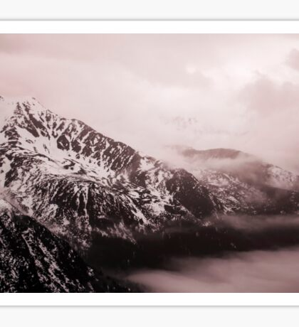 High rocky mountains in the snow. The Tatra Mountains in Poland. Moody vintage colors Sticker
