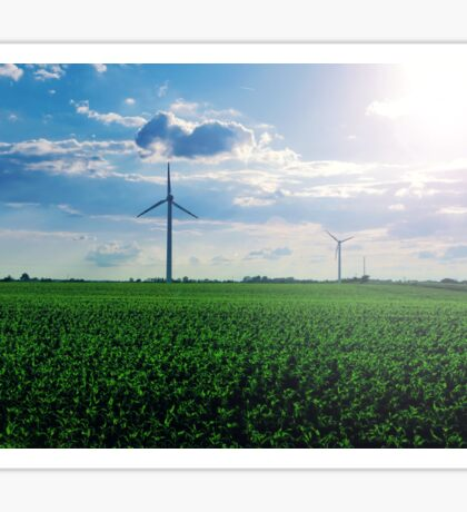 Beautiful landscape with fresh green grass, blue sky and windmills on the field Sticker