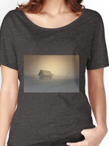 The old spooky house on the land of nowhere. Wooden house in the middle of the barren land. Scenic retro landscape Women's Relaxed Fit T-Shirt