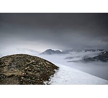Dark mountain landscape. Snowy mountains in the deep fog. No Man's land Photographic Print