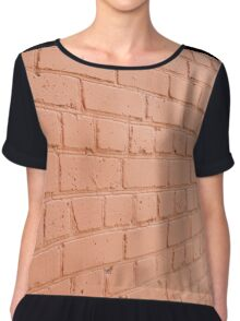 Angle view of a brick wall with a layer of red paint Chiffon Top
