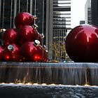 A Christmas Card from New York City - Manhattan Skyline Reflecting in Giant Red Balls by Georgia Mizuleva